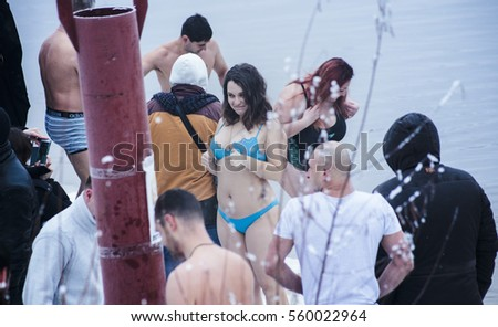 Kiev,Ukraine - Jan.19, 2017 : Orthodox Christians celebrate Epiphany with ice swimming . Jesus Christ's baptism in the river of Dniper