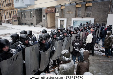 KIEV, UKRAINE - JAN 21: Police squads protect the government quarter of the common people on the snow winter street during anti-government protest Euromaidan on January 21, 2014, in Kyiv, Ukraine.  - stock photo