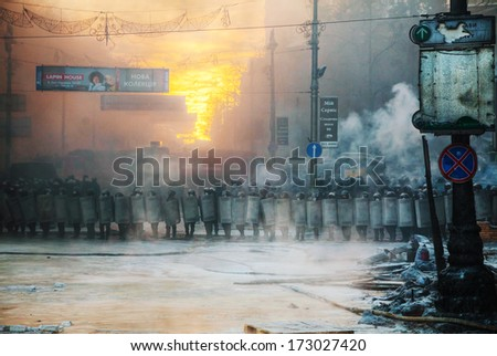 KIEV, UKRAINE - JANUARY 24: A row of the riot police at Hrushevskogo street on January 24, 2014 in Kiev, Ukraine. The anti-governmental protests turned into violent clashes during last week. - stock photo