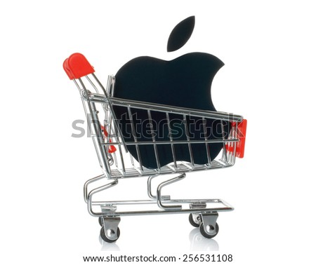 KIEV, UKRAINE - JANUARY 16, 2015: Apple logotype printed on paper and placed into shopping cart. Apple is an American multinational corporation, that sells consumer electronics and personal computers. - stock photo