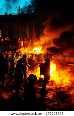 KIEV, UKRAINE - JANUARY 24: Barricade with the protesters at Hrushevskogo street on January 24, 2014 in Kiev, Ukraine. The anti-governmental protests turned into violent clashes during last week.
