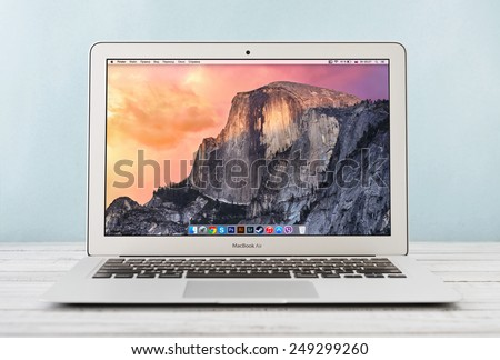 KIEV, UKRAINE - JANUARY 29, 2015: Brand new Apple MacBook Air Early 2014, designed and developed by Apple Inc., it was released on April 29, 2014 - stock photo
