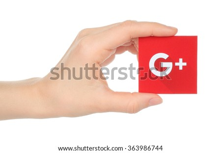 Kiev, Ukraine - January 15, 2016:Hand holds new Google plus logotype printed on paper and cut, on white background.Google is USA multinational corporation. - stock photo