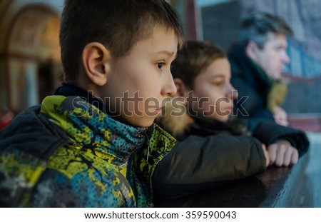 Kiev, Ukraine - January 8, 2016: IDPs children from Donbas on excursion at Saint Sophia Cathedral.