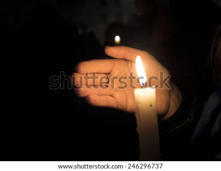 KIEV, UKRAINE - January 22, 2015: In Kiev, honored the memory the victims of the first activists Euromaidan. A girl holds a candle.