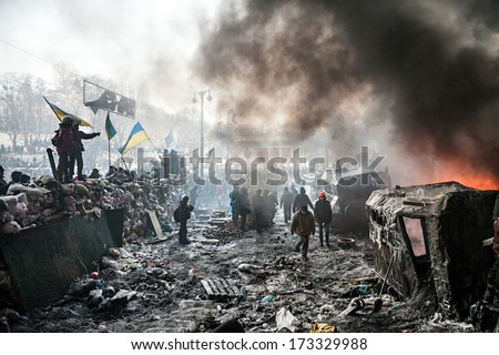 KIEV, UKRAINE - January 25, 2014: Mass anti-government protests in the center of Kiev. Barricades in the conflict zone on Hrushevskoho St. - stock photo