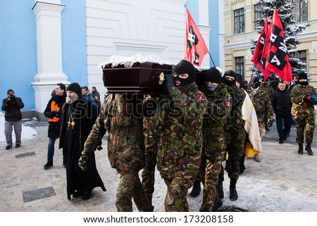 KIEV, UKRAINE - January 26, 2014: memorial service at St Michael's Cathedral on 25 year old Euromaidan activist Michail Zhiznevsky who was killed in Kiev  clashes with riot police on Hrushevskoho st