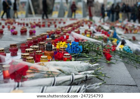 KIEV, UKRAINE - JANUARY 25, 2015: People light candles at Kiev's Independence square in solidarity with the victims of the attacks in Mariupol and other cities.