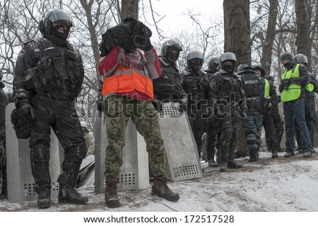 "KIEV, UKRAINE - 21 JANUARY: Protest against ""Dictatorship"" in Ukraine turns violent on Euromaidan in Kiev. Against the president Yanukovych on 21 January, 2014 in Kiev, Maidan, Ukraine"