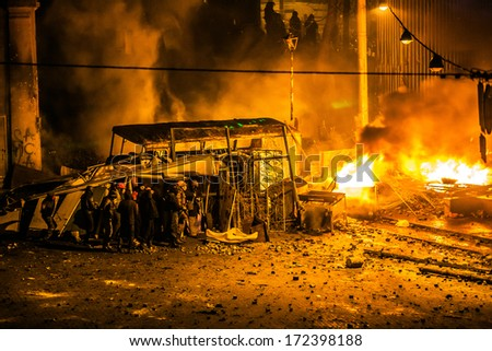 "KIEV, UKRAINE 20 JANUARY: Protest against ""Dictatorship"" in Ukraine turns violent on Euromaydan in Kiev. Against the president Yanukovych on 20 January, 2014 in Kiev, Maidan, Ukraine. - stock photo"
