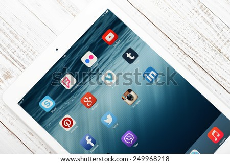 KIEV, UKRAINE - JANUARY 29, 2015: Social media icons on screen of iPad Air 2. Social media are most popular tool for communication, sharing information and content between people in internet network. - stock photo