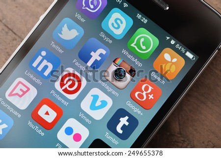 KIEV, UKRAINE - JANUARY 29, 2015: Social media icons on screen of smartphone. Social media are most popular tool for communication, sharing information and content between people in internet network. - stock photo