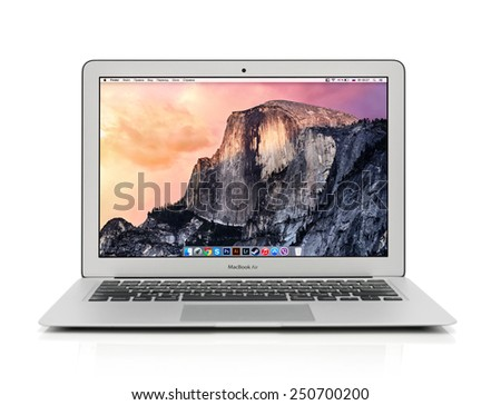 KIEV, UKRAINE - JANUARY 29, 2015: Studio shot of brand new Apple MacBook Air Early 2014 with home page on screen, designed and developed by Apple Inc., it was released on April 29, 2014 - stock photo