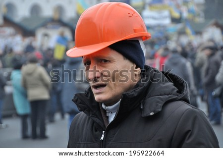 KIEV, UKRAINE - 24 JANUARY 2014: The head of free trade unions of Ukraine Mychailo Volinec gives an interview to unknown journalists during revolution on January 24, 2014 in Kiev, Ukraine