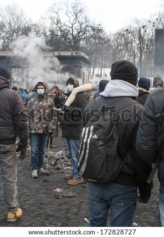 KIEV, UKRAINE - January 23, 2014: The morning after the violent confrontation,the fire and anti-government protests on the Hrushevskoho Street on January 23, 2014 in Kiev, Ukraine