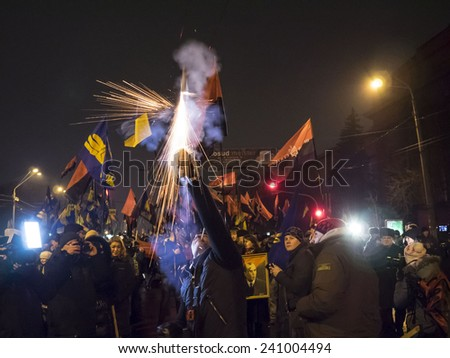 KIEV, UKRAINE - January 1, 2015: The torchlight procession in honor of the birthday of Stepan Bandera was held in the city center. It was attended by about four thousand people