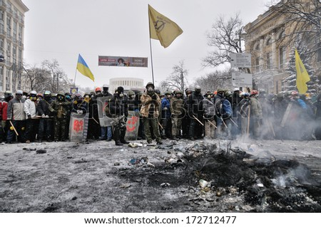 KIEV, UKRAINE � 22 JANUARY 2014: Unknown demonstrators prepare to fight with police in government district on January 22, 2014 in Kiev, Ukraine.