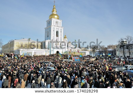 KIEV, UKRAINE -Â?Â? 25 JANUARY 2014: Unknown people visit the burial of Ukrainian revolutionary hero Michail Zhiznevskij on January 25, 2014 in Kiev, Ukraine. - stock photo
