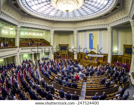 """KIEV, UKRAINE - January 27, 2015: Verkhovna Rada of Ukraine issued a statement conferring Russian the status of """"aggressor state"""". Deputies minute's silence in memory of those killed in Mariupol.  - stock photo"""