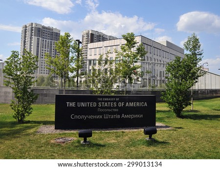 "Kiev, Ukraine - JULE 22, 2015: USA Embassy in Kiev. Granite plate with the inscription ""The Embassy of the USA "" in English and Ukrainian languages and building of embassy in the background - stock photo"