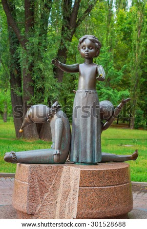 KIEV - UKRAINE, JULY - 30, 2015: A monument to children executed in 1941 in Babi Yar in Kiev by German forces and collaborators against the Soviet Union. - stock photo