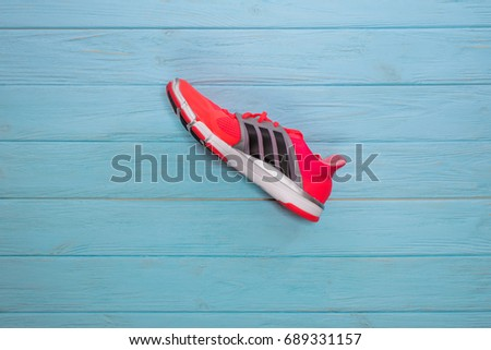 Kiev, Ukraine - July 2, 2017: Adidas Running boots. Adidas, multinational company. Blue background. Product shots. New model of shoes, modern aerodynamic design, light and beautiful sneakers.