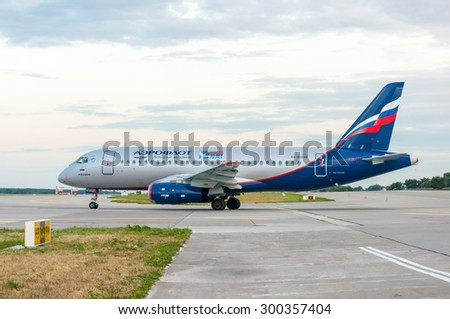 KIEV, UKRAINE - JULY 10, 2015: Aeroflot  SSJ 195-b taxis to teminal at KBP Airport on January 12, 2014. Aeroflot is the flag carrier and largest airline of the Russian Federation - stock photo