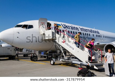 KIEV, UKRAINE- JULY 05: Airbus A319 of  Ukraine International Airlines at Kiev Boryspol airport on July 5, 2014. UIA is the flag carrier and national airline of Ukraine. - stock photo
