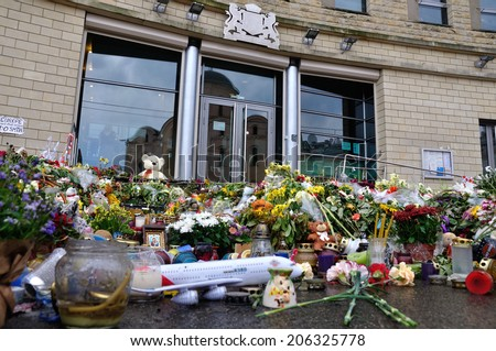 KIEV, UKRAINE - 21 JULY 2014: Bunches of flowers are near the embassy of the Netherlands in memory of killed people on flight of Boeing 777 of Malaysia Airlines on July 21, 2014 in Kiev, Ukraine