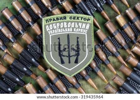 "KIEV, UKRAINE - July, 08, 2015. Chevron of Ukrainian volunteers corps with the words ""Ukrainian Volunteer Corps Right Sector"" with military ammunition"