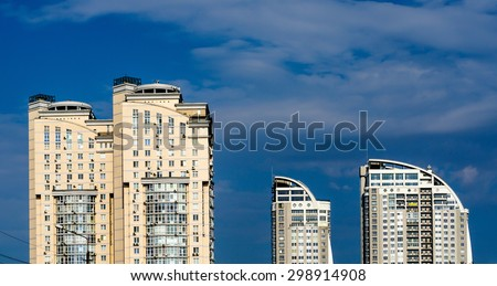 Kiev, Ukraine - July 20, 2015: Group of modern multi-storey yellow and white big houses on background of blue sky - stock photo