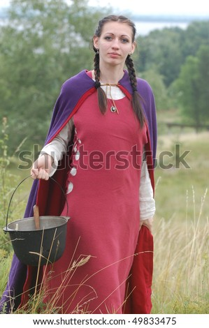 KIEV, UKRAINE - JULY 31: Member of history club Golden Capricorn wears medieval costume as she participates in historical festival in memory of King Vladimir July 31, 2009 in Kiev, Ukraine.