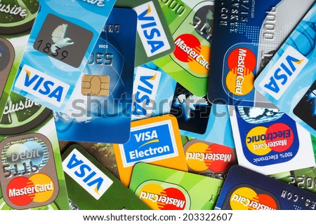 KIEV, UKRAINE - July 7: Pile of credit cards, Visa and MasterCard, credit, debit and electronic, in Kiev, Ukraine, on July 7, 2014.