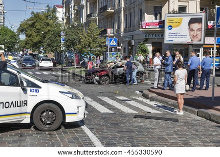 KIEV, UKRAINE - JULY 20, 2016: Police and explosives experts work on the site of a car explosion of famous independent Belarusian journalist Pavel Sheremet. Pavel Sheremet died in car in city center.