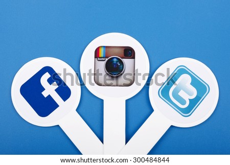 KIEV, UKRAINE - JULY 26, 2015: Popular social media  Facebook, Instagram, Twitter, printed on paper and placed on plastic signs on blue background. - stock photo