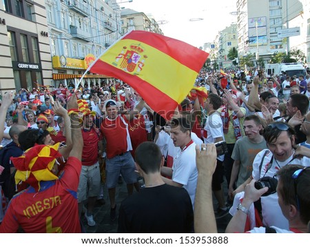 KIEV, UKRAINE Â?Â? 01 JULY 2012: The crowd of Spanish football national team fans celebrates on Euro-2012 on July 01, 2012 in Kiev, Ukraine. - stock photo