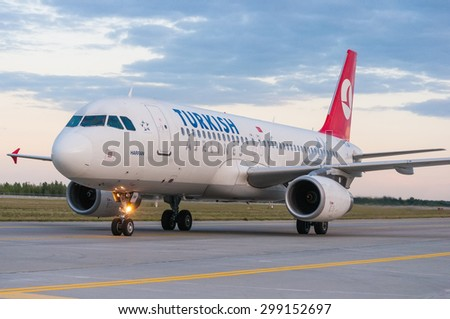 KIEV, UKRAINE - JULY 10, 2015: Turkish Airlines Airbus A320 at Borispol International Airport, Kiev, Ukraine. TurkisH Airline has over 18,000 employees and a fleet of 261