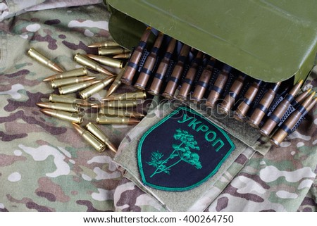 "KIEV, UKRAINE - July, 08, 2015. Ukraine Army unofficial uniform badge ""UKROP"" with military ammunition"