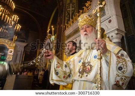 KIEV, UKRAINE - Jun 28, 2015: Primate of Ukrainian Orthodox Church Kiev Patriarchate Filaret during festive liturgy at St.Vladimir Patriarchal cathedral in occasion of baptism of Kievan Rus-Ukraine - stock photo