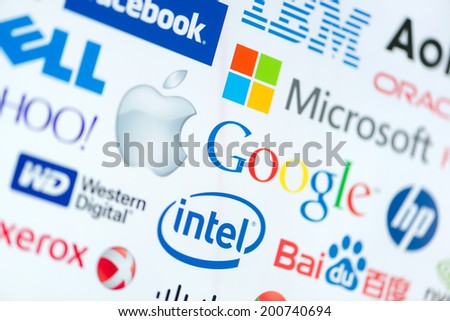 KIEV, UKRAINE - JUNE 12, 2014: A logotype collection of well-known world top companies of computer technologies on a monitor screen. Include Google, Apple, Microsoft, Intel and other logo. - stock photo