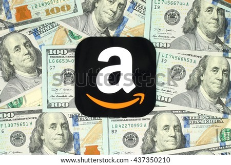 Kiev, Ukraine - June 13, 2016: Amazon icon printed on paper and placed on money background. Amazon is an American electronic commerce company.