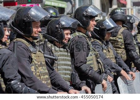 Kiev, Ukraine - June 12, 2016: Cordon of police wearing armor while protecting gay parade