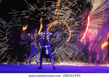 KIEV, UKRAINE - JUNE 14, 2014: Fire performance which took place in Kiev on 14 of June 2014  - stock photo