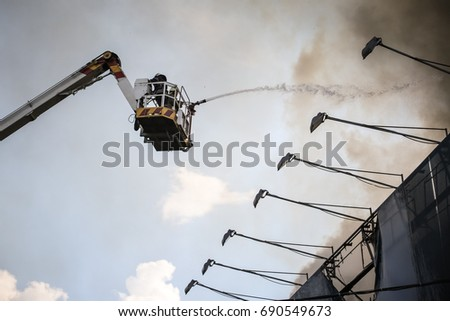 Kiev, Ukraine - June 20, 2017: Firefighters extinguish a fire in a burning building in central Khreshchatyk street in Kiev