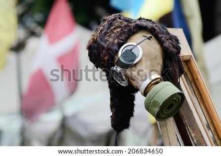KIEV, UKRAINE - JUNE 19: Protesters protection - gas mask ,military item in rioters camp on Maidan Nezavisimosti square (downtown of Kiev) after February revolution, on June 19, 2014 in Kiev,Ukraine