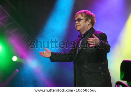 KIEV, UKRAINE - JUNE 30: Singer Elton John performs onstage the Anti-AIDS concert at a Fan Zone during the Euro 2012 soccer championship on June 30, 2012 in Kiev, Ukraine - stock photo
