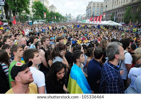 KIEV, UKRAINE - JUNE 15:Sweden and Ukrainian fans arrive in the fanzone during the match Euro 2012 between England - Sweden on June 15, 2012 in Kiev, Ukraine. Zone for the fans UEFA EURO Championship.