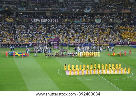 KIEV, UKRAINE, JUNE 11, 2012, Traditional Ceremony Before the Game, Stewards Holding Flags, National Teams, Ukraine against Sweden, Olympic Stadium, Documentary Editorial