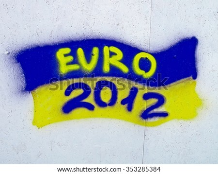 KIEV, UKRAINE - JUNE 19: Ukrainian flag graffiti with EURO 2012 text on June 19, 2012 in Kiev, UKRAINE. EURO 2012 football championship started on June 08, 2012 in Ukraine, Poland.  - stock photo