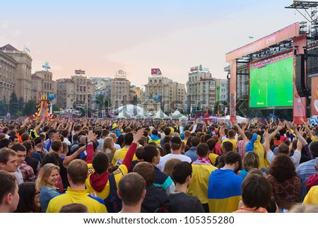 KIEV, UKRAINE - JUNE 15: Ukrainian, Swedish and English fans in fanzone before match Euro 2012 between Ukraine - France and England - Sweden on June 15, 2012 in Kiev, Ukraine. Zone for the fans EURO - stock photo
